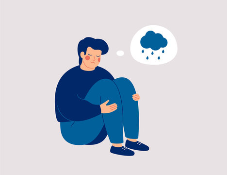 Unhappy man hugs his knees and sits on the floor with rainy cloud above his. Sad boy is crying.  Male character feels depression, sorrow, grief. Mental disorder or illness concept. Vector illustration