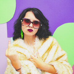 A beautiful lady with glasses, dark red lipstick, a white faux fur coat and earrings on a pop art...