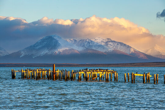 Sunrise over a landscape with fjord and abandoned pier at Puerto Natales in southern Chile