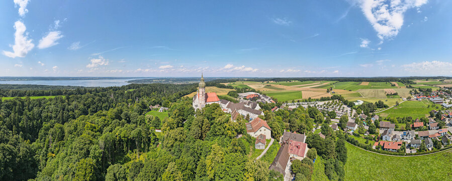 Aerial view on the Kloster Andechs Monastery and the Ammersee lake in the background