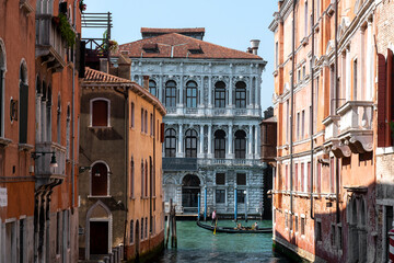 Venice canal with gondola and typical buildings.