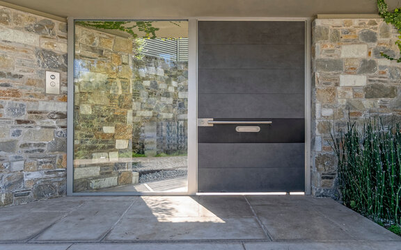contemporary house front entrance stone, glass and metal door, Athens Greece