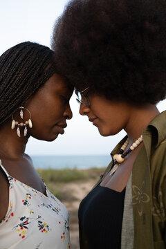 Black girlfriends enjoying time together on beach