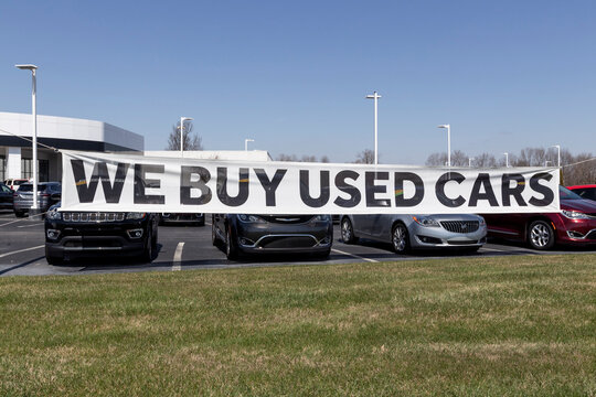 WE BUY USED CARS at a local preowned or used car dealership.
