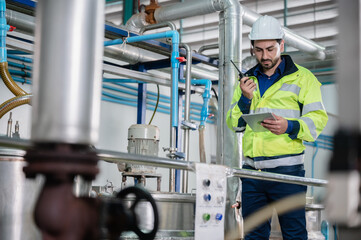 Fototapeta professional inspection control scientist in uniform are working for fruit juice production industry in food manufacturing factory, water drink checking and beverage research in laboratory obraz