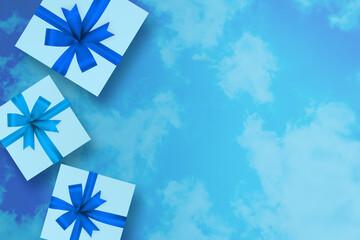 Obraz Paczka z prezentami na niebieskim tle - fototapety do salonu