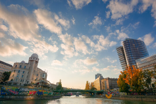 vienna, austria - OCT 17, 2019: cityscape of vienna with danube channel. beautiful urban scenery in evening light. gorgeous sky above the skyline