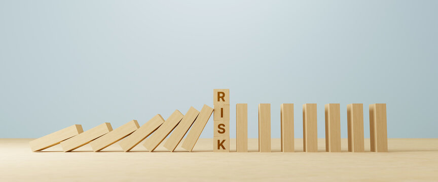 Risk concept. Wooden block stopping domino effect for business. 3d illustration