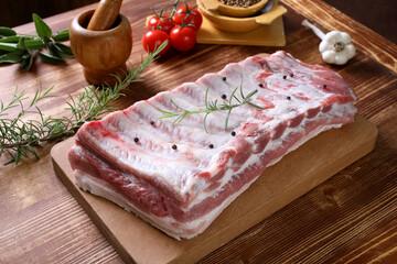 Fototapeta carne cruda di porco petto con osso obraz
