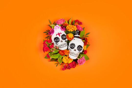 Day of the dead, Dia De Los Muertos, halloween Celebration Background. Sugar Skull, calaverita, marigolds flowers, Orange Copy Space. Traditional Mexican culture festival flyer. Flat lay, top view.