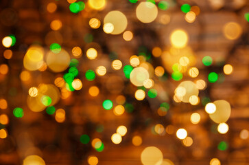 Defocused gold lights. Abstract holiday background. Beautiful shiny Xmas lights. Glowing magic...