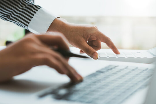 business executives are discussing to change their business concept to increase profits and the strength of their business with using laptop for work.