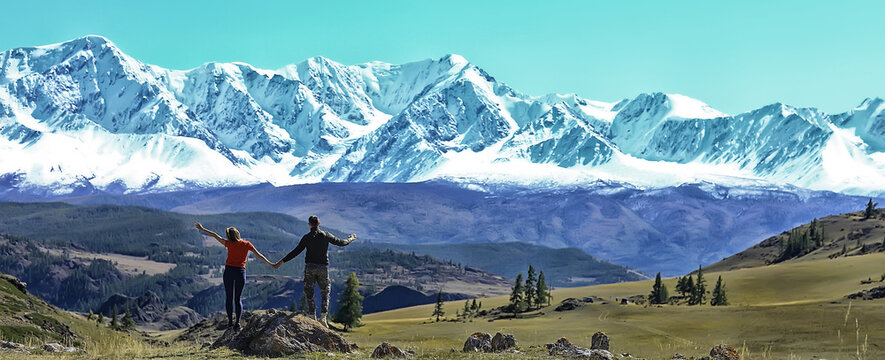 couple hands up mountains, landscape adventure active view