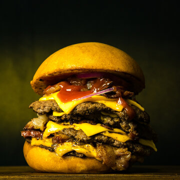 Tasty Fresh Home Made Gourmet Burger on Wooden Table With Dark Background