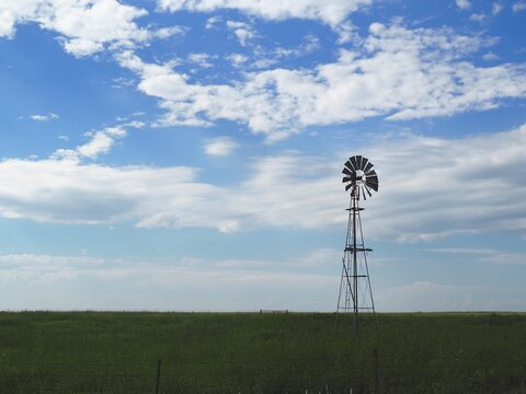 Old-fashioned windmill pumping water in the Flint Hills of Kansas.