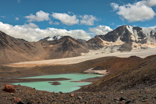 Mountain landscape with glaciers and lake