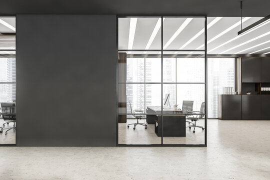 Black framed glass wall with grey detail near office entrance
