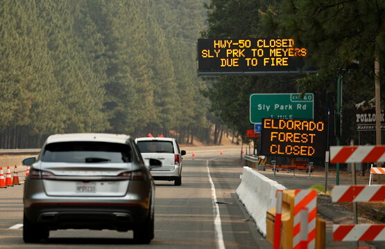 Signs informing of highway closure, 40 miles of Highway 50, are seen closed from Pollock Pines to South Lake Tahoe, due to Caldor Fire, in Kyburz
