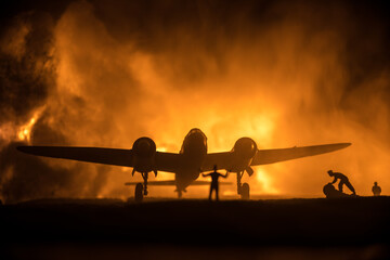 Obraz German Junker (Ju-88) night bomber at night. Artwork decoration with scale model of jet-propelled plane in possession. Toned foggy background with light. War scene. - fototapety do salonu