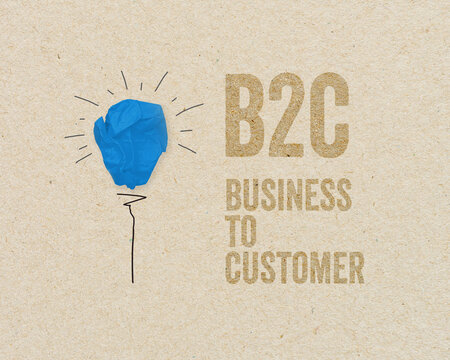 Blue paper light bulb with B2C - Business to customer on brown recycled paper background