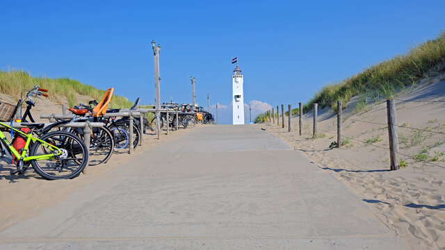 The lighthouse in Noordwijk aan Zee in front of the entrance to the beach in the Netherlands