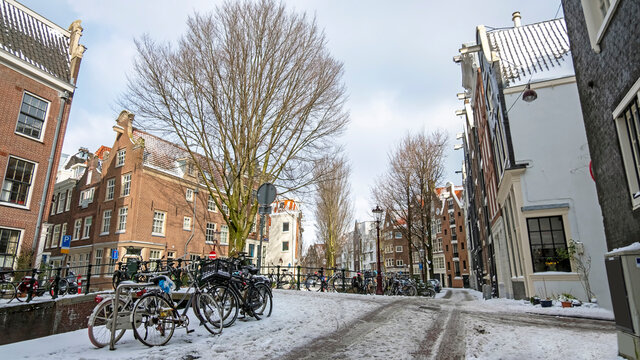 City scenic from a snowy Amsterdam in winter near the Nieuwmarkt in the Netherlands