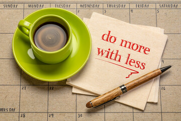 do more with less motivational note on napkin with a cup of coffee, productivity, smart work,...