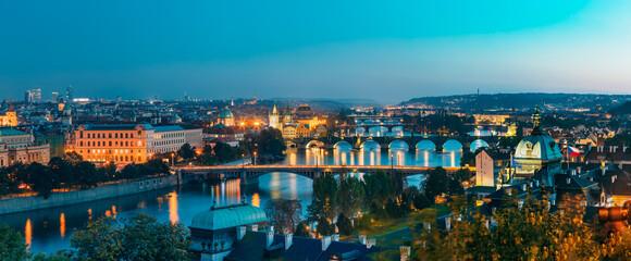 Obraz Prague, Czech Republic. Evening Panoramic View Of Evening Cityscape In Night Lighting. Charles Bridge, Manes Bridge, Straka Academy. Famous Landmarks, UNESCO World Heritage - fototapety do salonu