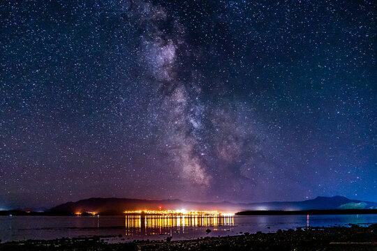 night view to small town at Mount Waddington many stars on dark sky.