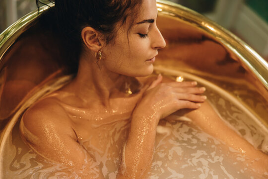 Glamorous woman having a relaxing bath