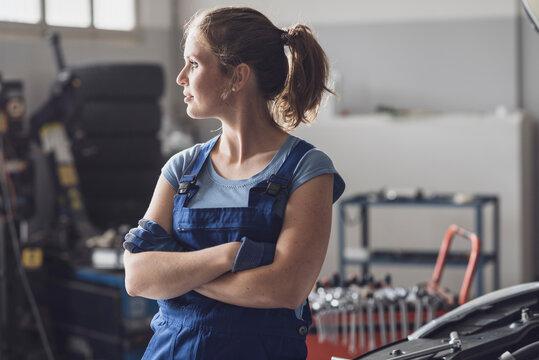 Portrait of female mechanic in the auto repair shop
