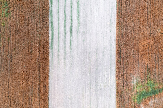 Aerial top down drone shot of interesting pattern on a rural countryside crop field