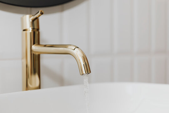 Golden faucet with running water