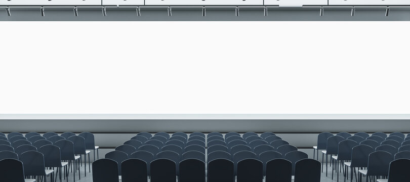 Panoramic grey auditorium with seating and empty screen with mock up place for your advertisement. Show premiere and entertainment concept. 3D Rendering.