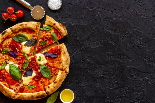 Delicious pizza with cheese tomatoes sauce and basil
