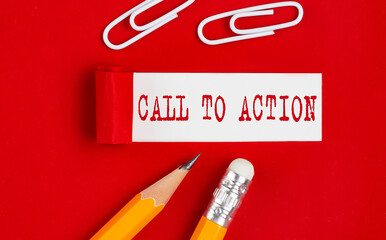 CALL TO ACTION message written under torn red paper with pencils and clips, business concept