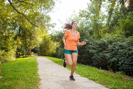 Female Runner Jogging during Outdoor Workout in a Park
