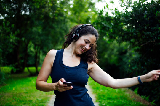 Happy girl in listen music in headphones