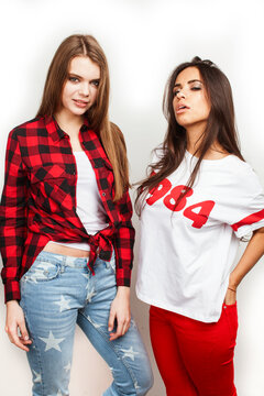 best friends teenage girls together having fun, posing emotional on white background, besties happy smiling, lifestyle people concept, blond and brunette multi nations