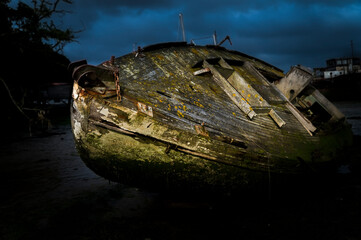 Old abandoned ship wreck on the river bank