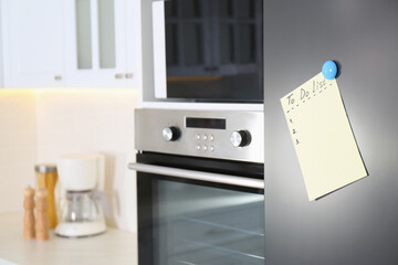 Blank To do list on fridge in kitchen. Space for text
