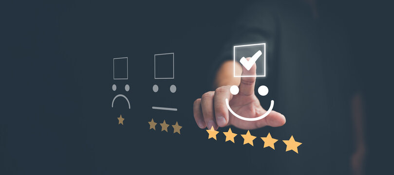 Customer service and Satisfaction concept, Business people touching the virtual screen on the happy Smiley face icon to give satisfaction in service. rating very impressed..
