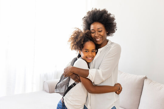 Getting ready for school. Shot of a mother getting her child ready for school. Mother sending off her elementary age Child to school during. Mom gets daughter ready for school in the morning