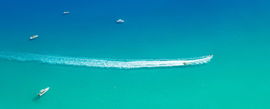 Speed boat with slider leave trail on water, sea panorama from above