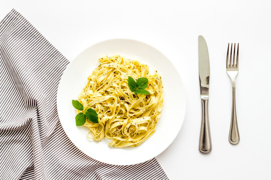 Plate of pasta fettuccine with cream sauce and herbs