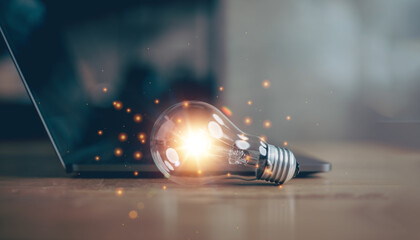 light bulb with laptop computer, idea of inspiration from online technology, innovation idea concept, Self learning or education knowledge and business studying concept.