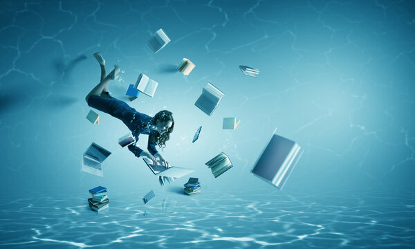 Woman with laptop underwater . Mixed media