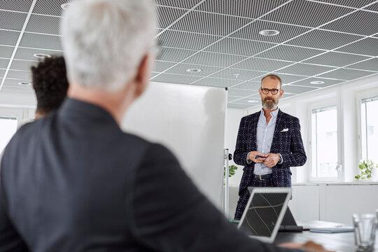 Man talking during business meeting