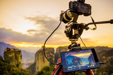 Obraz Camera on tripod and Meteora monasteries - fototapety do salonu