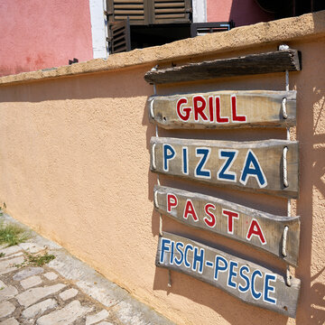 Advertisement for a typical restaurant in an alley in the old town of Krk in Croatia